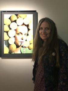 VICENÇ BATALLA | Ouka Leele, en Arles, delante de la obra original de la serie Peluquería que ilustra el cartel de los Rencontres de la Fotografía 2019