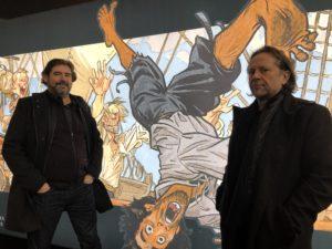 VICENÇ BATALLA | El dibujante Juanjo Guarnido y el guionista Alain Ayroles en el Festival de Angulema en enero, con el personaje de El Buscón en las Indias de fondo
